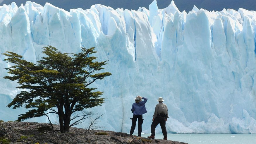 Calafate, Patagonia, Argentina - December, 7th 2004:tourists stand on a hill overlooking the Perito Moreno Glacier in Patagonia