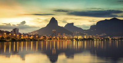 Sunset behind mountains in Rio de Janeiro with water reflection