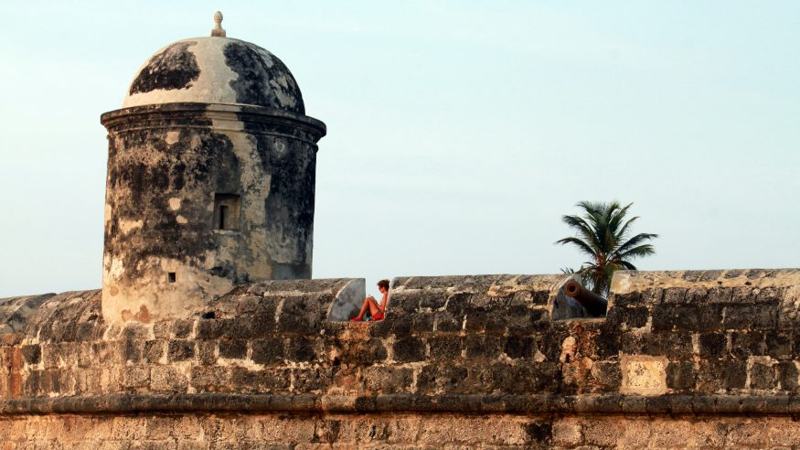Cartagena_woman relaxing on fortress wall