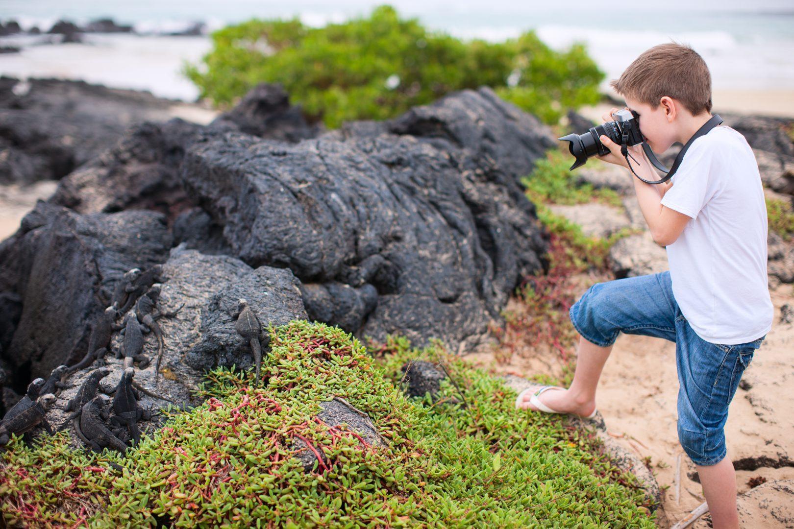 Photographing iguana in Galapagos