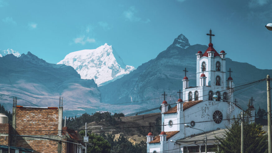A church seen front of the Andes Mountains Cordillera Blanca in the city of Huaraz, Peru.