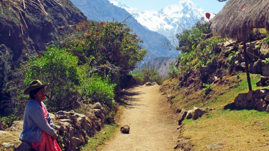 Peru_Machu-Picchu_Inca-Trail_Woman-on-trail-leading-to-snowy-mountains