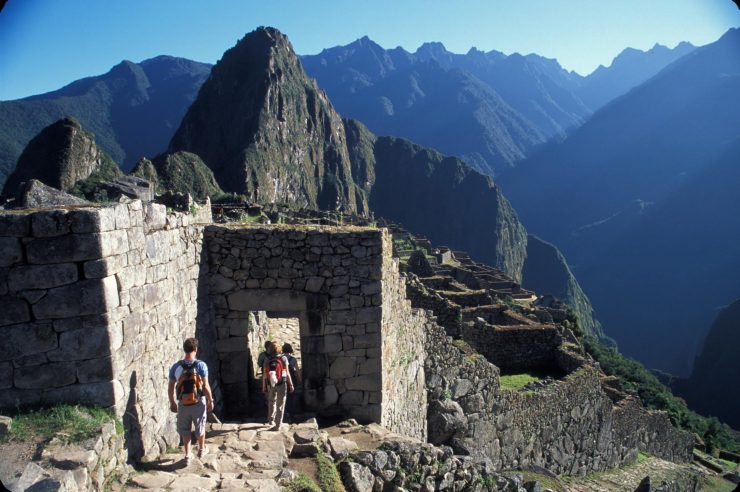 Hikers at the gate over Machu Picchu